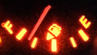 Photo of a gas gauge with the needle almost to full