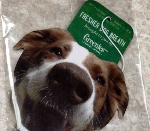 photo of a dog face air freshener with the words fresher dog breath brought to you by Greenies
