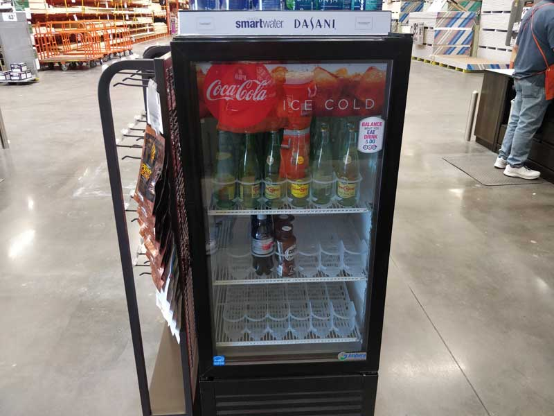 photo of a small clear front refrigerator that is mostly empty