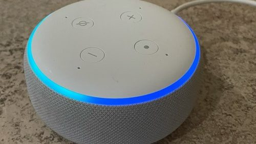 small smart speaker lit up to indicate it's listening.